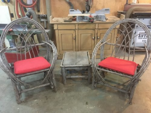Rustic cedar bentwood outdoor chairs and table.